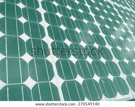 Solar panel photovoltaic cells array close up illustration green energy concept. Solar energy, an eco-friendly power source, uses the sun to generate clean renewable energy. - stock photo