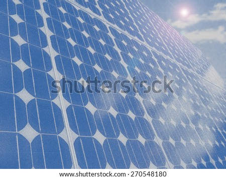 Solar panel photovoltaic cells array with blue sky and cumulus clouds reflected in the panels illustration. Solar energy, an ecofriendly power source, uses the sun to generate clean renewable energy. - stock photo