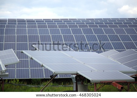 Solar panel produces green, environmentally friendly energy from the sun  - Stock Photo
