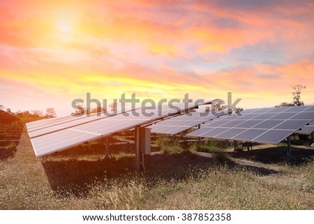 Solar panel produces green, environmentaly friendly energy from the setting sun - stock photo