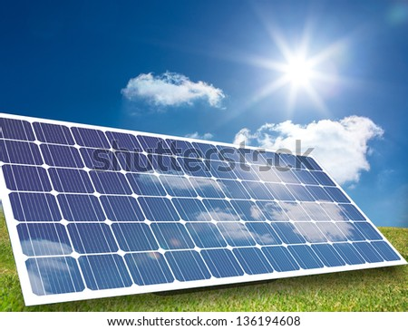 Solar panel reflecting light in a sunny field