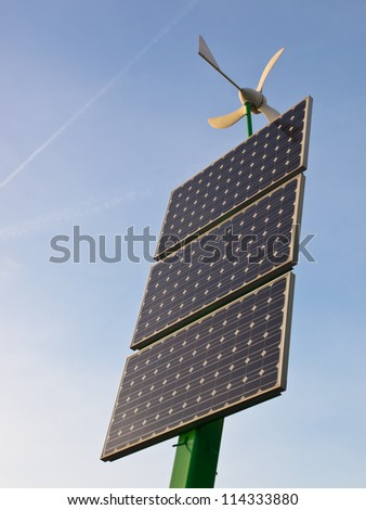 Solar panel with a miniature wind turbine on top