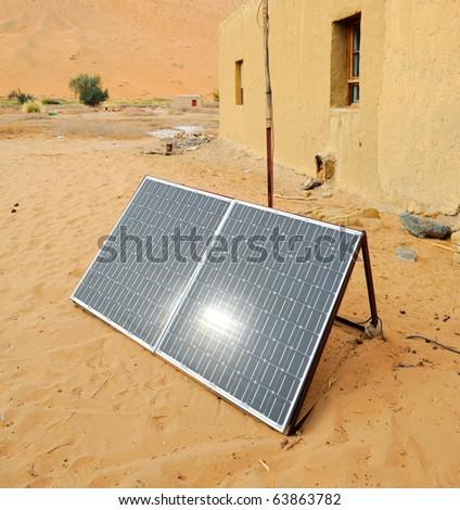 solar panel with desert house - stock photo