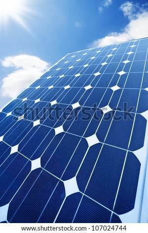 Solar panel with shining sun - stock photo