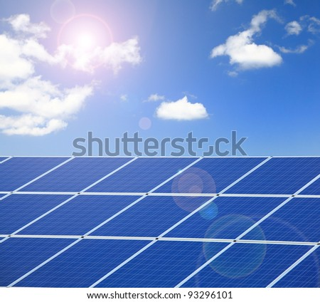 Solar Panel with sunlight and blue sky background