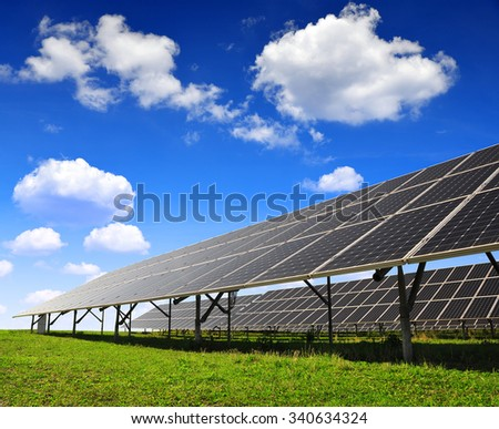 Solar panels against blue sky with clouds. Clean energy. - stock photo