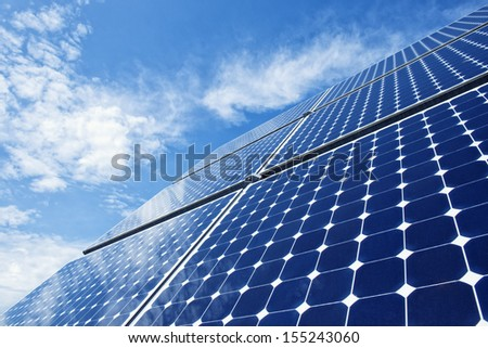 Solar Panels Against The Deep Blue Sky - stock photo