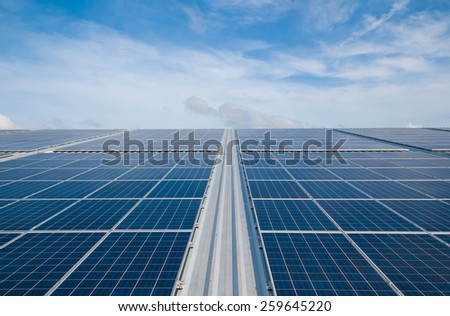 Solar Panels Against The Deep Blue Sky And Clouds  - stock photo