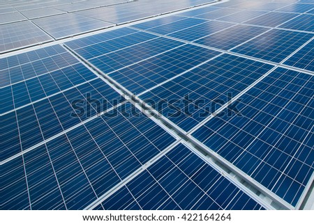 Solar Panels Against The Deep Blue Sky And Clouds. - stock photo