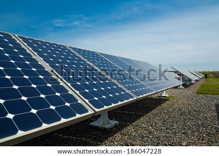 Solar panels aligned work - stock photo