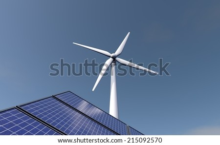 Solar panels and a windmill in the background - stock photo