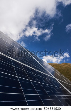 Solar panels and blue sky, electrical energy production and environmental conservation concept