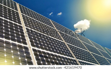 Solar panels and sky background - stock photo