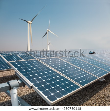 solar panels and wind power farm , new energy background  - stock photo