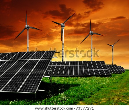 Solar  panels and wind turbine in the setting sun