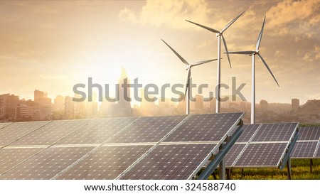 solar panels and wind turbines against city on background under blue sky. Header for website - stock photo
