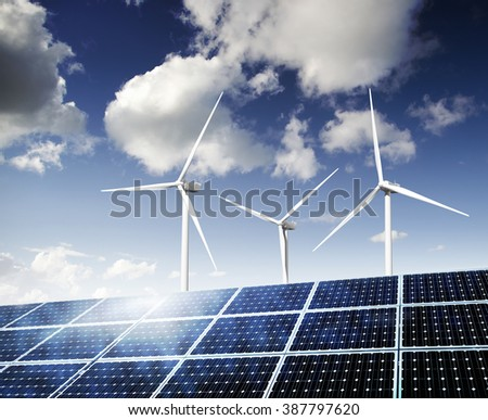Solar panels and wind turbines generating power. - stock photo