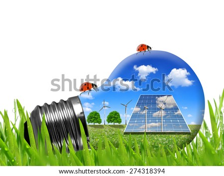 Solar panels and wind turbines in light bulb. Green energy concept. - stock photo
