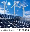 Solar panels and Wind Turbines sunny day blue sky - stock photo