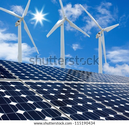 Solar panels and Wind Turbines sunny day blue sky