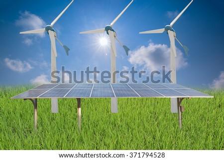 solar panels and wind turbines under blue sky - stock photo