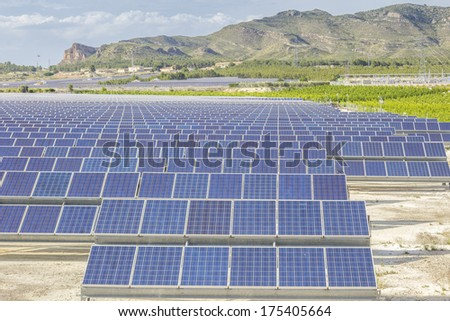 Solar panels as source of renewable ecologic energy - stock photo