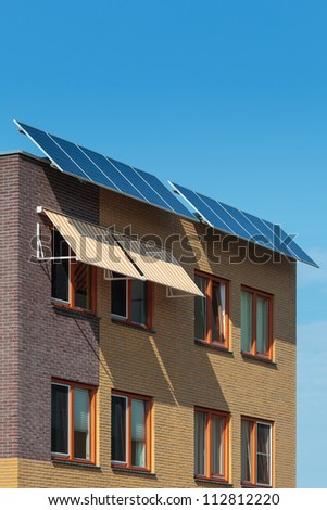 Solar panels attached on the front of a newly build European house - stock photo