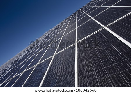 Solar panels carpet with blue sky - stock photo