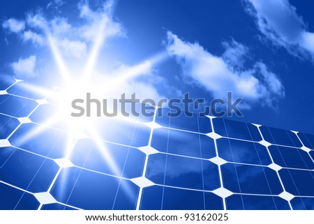 solar panels - clean energy source on the background of sky and bright sun - stock photo