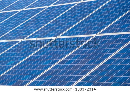 solar panels collecting energy from the sun - stock photo