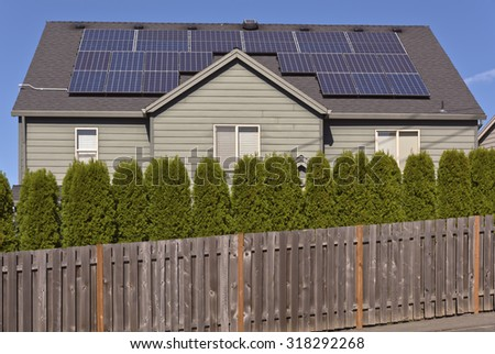 Solar panels facing the sun on a roof of a house. - stock photo