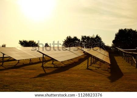 stock-photo-solar-panels-farm-in-a-field