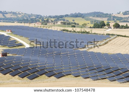 Solar panels for renewable energy on the hill (Marche - Italy) - stock photo