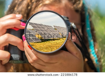 Solar panels from the eyes of a little girl. - stock photo