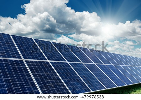 Solar panels generate power energy on blue sky at daytime