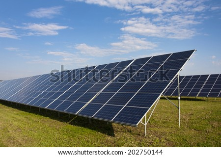 Solar panels in a field - stock photo