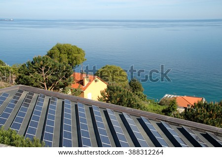Solar panels in Bergeggi, Italian Riviera. In the background the sea and above solar cells. - stock photo