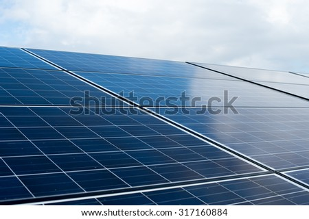 Solar panels in the daytime - stock photo