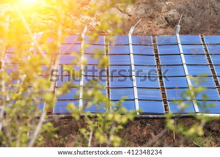 Solar panels in the mountains - stock photo