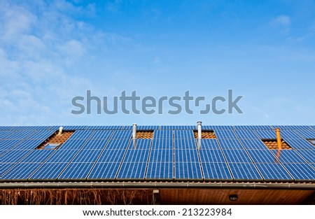 Solar panels installed on the roof of building - stock photo