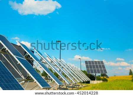 Solar panels near a modern factory