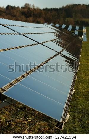 Solar panels of field solar power plant - stock photo