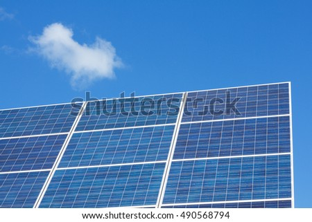 Solar panels on a blue sky