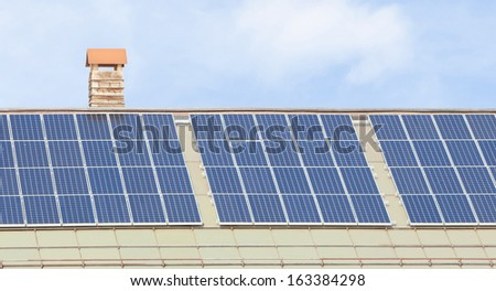 Solar panels on a building roof - stock photo