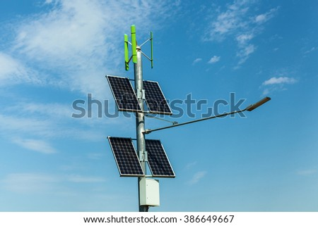 solar panels on a pole, urban lighting with solar panels, independent lighting on the roads, alternative sources of electricity for lighting cities