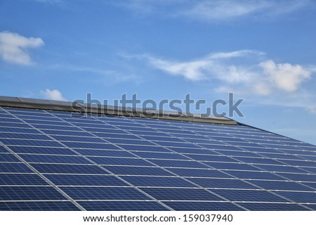 Solar panels on a roof of a farm building in Schleswig-Holstein, Germany - stock photo