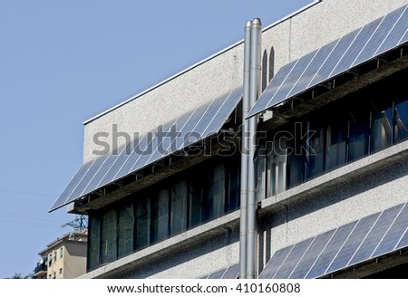 Solar panels on buildings in the suburbs.