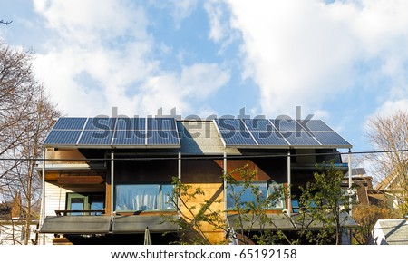 Solar panels on domestic roof - stock photo
