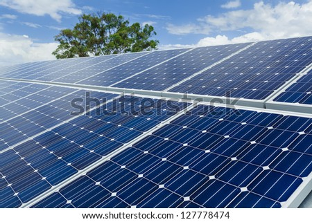 Solar panels on factory roof. - stock photo