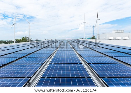 Solar panels on factory roof - stock photo